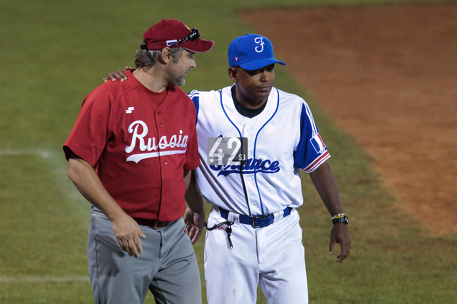21 August 2010: Gerardo Leroux of Team France talks to Russia team manager Alexander Volkov  Russia 13-1 win in 7 innings over France, at the 2010 European Championship, under 21, in Brno, Czech Republic.
