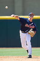 Shortstop Jake Overbey #22 of the Ole Miss Rebels throws to first during the NCAA Regional baseball game against the Texas Christian University Horned Frogs on June 1, 2012 at Blue Bell Park in College Station, Texas. Ole Miss defeated TCU 6-2. (Andrew Woolley/Four Seam Images).