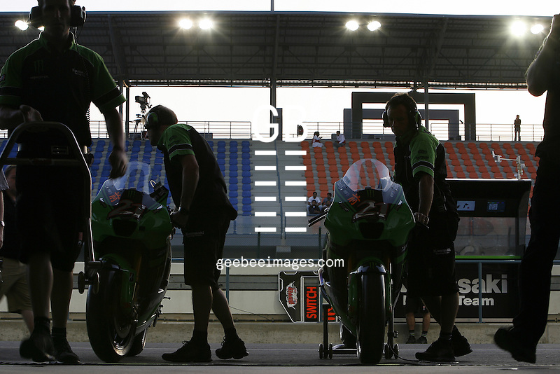2008 MotoGP World Championship, Round 1, Losail, Qatar, 9 March 2008..With scrutineering done mechanics take the bikes back to the garage and get all the settings ready for racing.