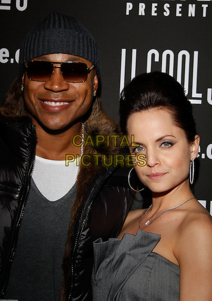 LL COOL J (JAMES TODD SMITH) & MENA SUVARI .At the Key Club Grand Re-Opening,West Hollywood, CA, USA,.29th January 2010..portrait headshot  grey gray strapless  hat sunglasses brown fur puffa sleeveless body warmer puffer beanie silver hoop earrings smiling .CAP/ADM/RAT.©Ratianda/Admedia/Capital Pictures
