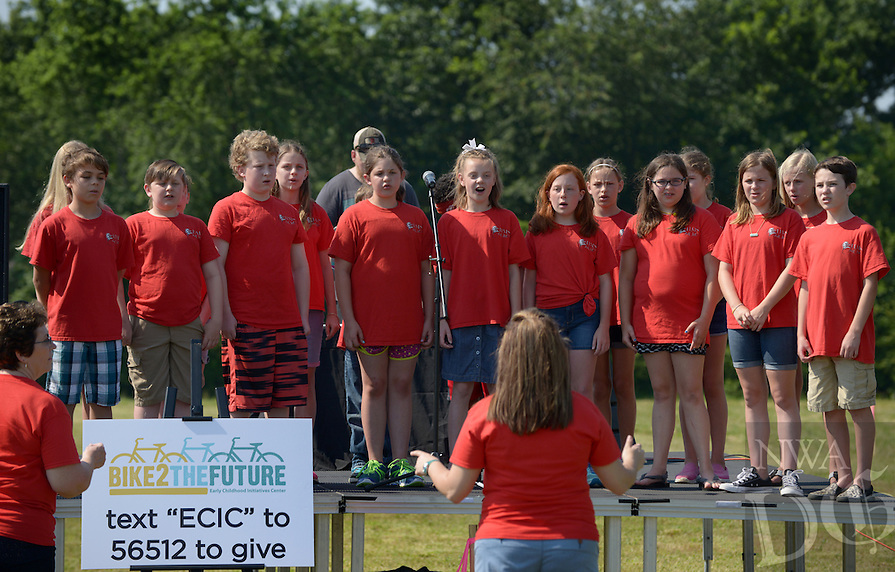 NWA Democrat-Gazette/BEN GOFF @NWABENGOFF<br /> The Old High Middle School choir sings on Saturday June 11, 2016 during the Helen R. Walton Children's Enrichment Center's 'Bike 2 the Future' event at the site of the center's new facility on N.E. J Street in Bentonville. Families decorated their bikes at Lawrence Plaza and rode to the site, where rendering of the plans for the new facility were unveiled along with games and activities.