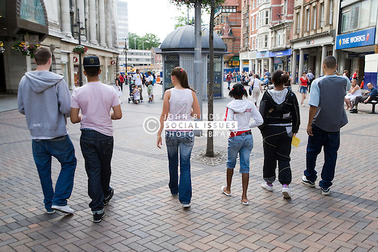 Group of teenagers walking down the street together,