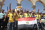 Palestinian supporters of the radical Islamist movement Hamas raise their hands and four fingers, a sign that protesters say symbolizes the Rabaah al-Adawiya mosque in Cairo that was cleared last week by Egyptian security forces, during a rally in support of Egypt's deposed president Mohamed Morsi, outside al-Aqsa mosque compound in Jerusalem on August 23, 2013. Egyptian security and military forces deployed Friday around Cairo, closing off traffic in some major thoroughfares and in the city center ahead of protests by supporters of ousted President Mohammed Morsi. Photo by Saeed Qaq
