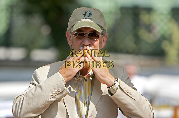 STEPHEN SPIELBERG.Arriving at Hotel Excelsior for the 61st Venice Film Festival, Italy,1st September 2004..half length blowing kiss gesture cap.Ref: OME.www.capitalpictures.com.sales@capitalpictures.com.©Capital Pictures.