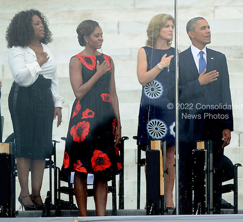 From left to right: Oprah Winfrey, first lady Michelle Obama, Ambassador Caroline Kennedy, and United States President Barack Obama listen to the National Anthem at the Let Freedom Ring ceremony on the steps of the Lincoln Memorial to commemorate the 50th Anniversary of the March on Washington for Jobs and Freedom<br /> Credit: Ron Sachs / CNP