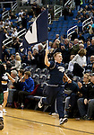 January 14, 2012:   Nevada Wolf Pack cheerleader brings the flag onto the court before their game against the Hawai'i Rainbow Warriors during their NCAA basketball game played at Lawlor Events Center on Saturday night in Reno, Nevada.
