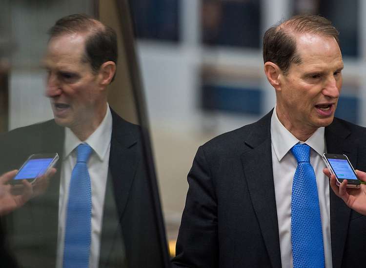 UNITED STATES - JUNE 17: Sen. Ron Wyden, D-Ore., speaks with a reporter as he arrives in the Capitol on Wednesday, June 17, 2015. (Photo By Bill Clark/CQ Roll Call)