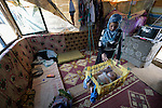 Khawla Ismael rocks her four-month old daughter Siham inside their tent in the El Rahmeh settlement of Syrian refugees in Bhannine, a village in the Akkar district of northern Lebanon. Lebanon hosts some 1.5 million refugees from Syria, yet allows no large camps to be established. So refugees have moved into poor neighborhoods or established small informal settlements in border areas. International Orthodox Christian Charities, a member of the ACT Alliance, provides a variety of support for families in this settlement, including water and sanitation facilities. Ismael and her family fled fighting in their home town of Homs.