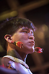 A Kuikuro warrior wears colourful feather ear decorations at the first ever International Indigenous Games, in the city of Palmas, Tocantins State, Brazil. The games will start officially with an opening ceremony on Friday the 23rd October. Photo © Sue Cunningham, pictures@scphotographic.com 21st October 2015