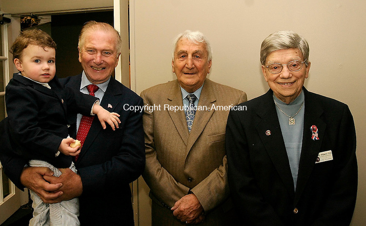 WATERBURY, CT - 01 MARCH 2005 - 050105JS10 Charter members Gordon Elliott, holding his grandson Jordan Elliott, Frank 'Cappy' DeBlasio and Joe Sileo during the Olympian Club of Greater Waterbury's 35th annual scholarship breakfast held Sunday at The Hills Restaurant at Western Hills Golf Course in Waterbury. The club has given $500,000 in scholraships in the last 35 years to graduates of Greater Waterbury.  <br /> --Jim Shannon Photo --Frank 'Cappy' DeBlasio; Joe Sileo, Gordon Elliott are CQ