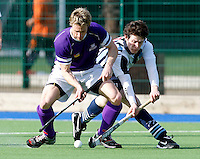 Pete Turner (L) of Sevenoaks comes under pressure from Daniel Walsh (R) of Hampstead during the England Hockey League Mens Semi-Final Cup game between Hampstead & Westminster and Sevenoaks at the Paddington Recreation Ground, Maida Vale on Sun March 21, 2010