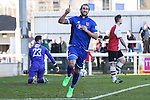 Ollie Palmer of Grimsby Town (centre)  celebrates scoring the opening goal against Woking during the Vanamara Conference League match at the Kingfield Stadium, Woking, Surrey<br /> Picture by David Horn/eXtreme aperture photography +44 7545 970036<br /> 07/03/2015