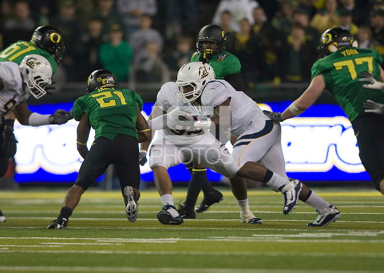October 6th, 2011:  D.J. Holt California tries to tackle LaMichael James of Oregon during a game at Autzen Stadium in Eugene, Oregon - Oregon defeated Cal 43 - 15