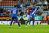 Tuesday, 7 May 2013<br /><br />Pictured: Garry Mork of Swansea City is blocked by Arouna Kone of Wigan Athletic while ( 10 ) Shaun Maloney of Wigan Athletic looks on <br /><br />Re: Barclays Premier League Wigan Athletic v Swansea City FC  at the DW Stadium, Wigan