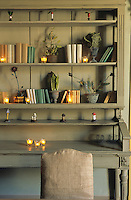 This bespoke dresser in the dining room houses books and a collection of small ceramic mushrooms