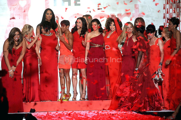 Jordin Sparks, Kristin Chenowethm Raven Symone, Kimora Lee Simmons Bethenny Frankel, Kim Kardashian, Joan Collins, Heidi Klum, Estelle, and Robin Roberts on the runway at the Heart Truth Fall 2010 Fashion Show during Mercedes-Benz Fashion Week at The Tent at Bryant Park in New York City. February 11, 2010. Credit: Dennis Van Tine/MediaPunch