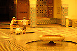 Children look at a fountain in the Marrakesh Museum in Marrakesh, Morocco.