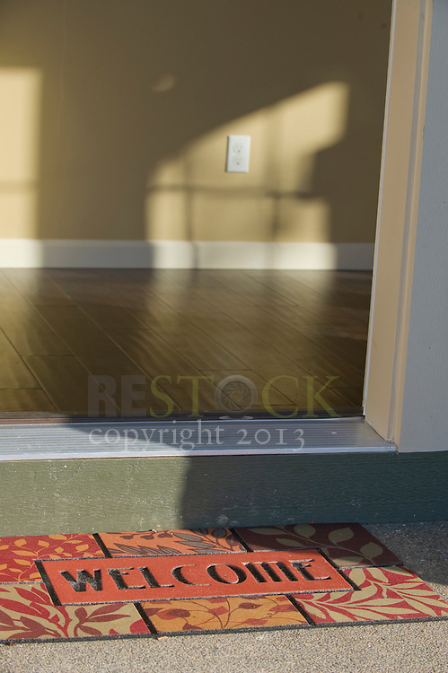 'Welcome' Mat and Open Door
