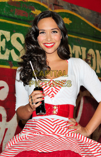 Myleene Klass .Launches a pop-up Coca-Cola Soda Bar at Selfridges, London, England..The retro soda bar has been created to mark the company's milestone 125th anniversary..June 17th, 2011.half length red white striped stripes dress  cardigan 50s style fashion sitting bottle drink beverage hand on hip nail varnish polish lipstick belt stars rings .CAP/CJ.©Chris Joseph/Capital Pictures.
