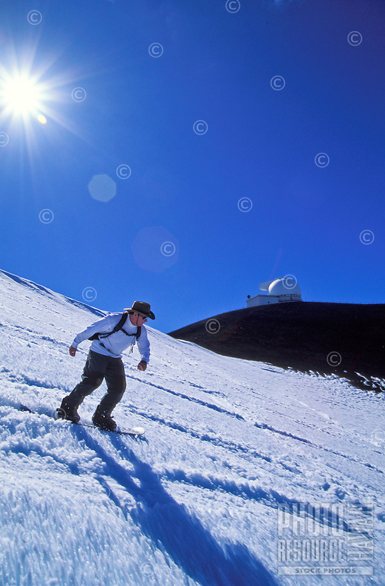 Man snowboarding at Mauna kea, Big island fo Hawaii