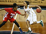 SIOUX FALLS MARCH 22:  Kiki Robertson #23 of Alaska Anchorage drives toward Camille Dash #4 of Francis Marion during their quarterfinal game at the NCAA Women's Division II Elite 8 Tournament at the Sanford Pentagon in Sioux Falls, S.D.  (Photo by Dick Carlson/Inertia)