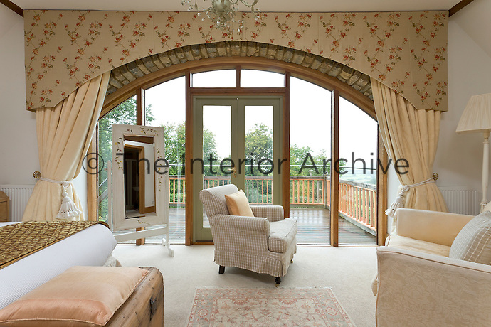 The focus of the master bedroom is an arched window which opens onto a spacious balcony