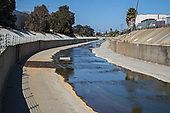 Ballona Creek, once a meandering creek, is now a concreted nine-mile waterway that drains the Los Angeles Basin and watershed down into the Pacific Ocean, Culver City, California, USA