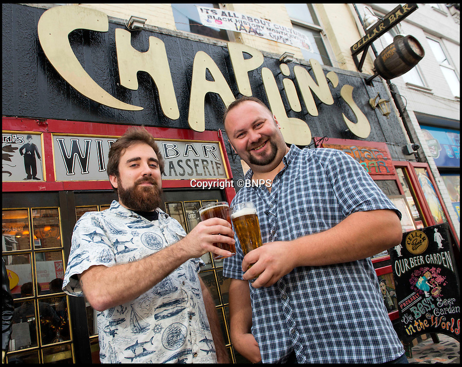 BNPS.co.uk (01202 558833)<br /> Pic: TomWren/BNPS<br /> <br /> Geoff Popple (left) and Carl Filer pub managers for Chaplins & The Cellar Bar.<br /> <br /> A beer garden likened to 'the set of a David Lynch film' has been named the best in the country. <br /> <br /> Chaplin's Cellar Bar's backyard lay empty and practically unused until it was bought by Harry Seccombe, formerly the owner of a local builders' merchants, a decade ago.<br /> <br /> But now punters can sip their drinks surrounded in a three-level haven of exotic plants, druid style murals and even a suit of armour following a radical transformation. <br /> <br /> And in recognition of this innovation the pub, located in a busy suburb of Bournemouth in Dorset, has been awarded the title of having 'Britain's Best Beer Garden 2016'.