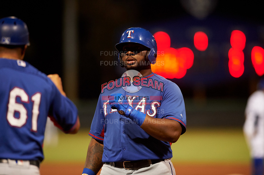 AZL Rangers Tyreque Reed (5) is congratulated by Guilder Rodriguez (61) after getting a hit during a rehab assignment in an Arizona League game against the AZL Dodgers Mota at Camelback Ranch on June 18, 2019 in Glendale, Arizona. AZL Dodgers Mota defeated AZL Rangers 13-4. (Zachary Lucy/Four Seam Images)