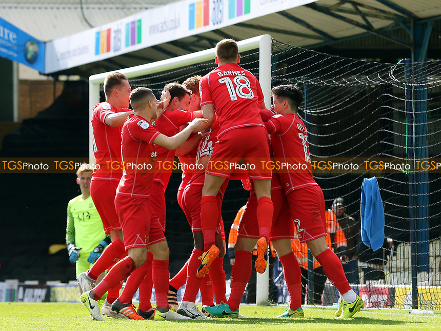 MK Dons players congratulate Joe Walsh after scoring their opening goal during Southend United vs MK Dons, Sky Bet EFL League 1 Football at Roots Hall on 17th April 2017