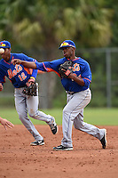 New York Mets second baseman Jorge Rivero (24) throws to first after shortstop Amed Rosario (12) flipped the ball for the double play attempt during a minor league spring training game against the St. Louis Cardinals on March 27, 2014 at the Port St. Lucie Training Complex in Port St. Lucie, Florida.  (Mike Janes/Four Seam Images)