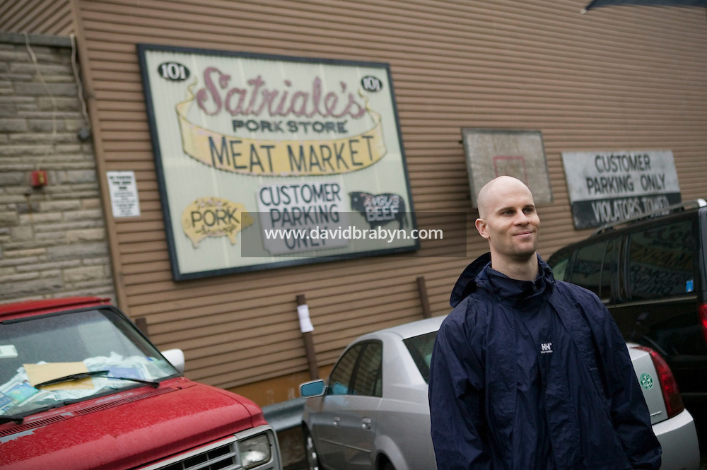 12 March 2006 - Kearny, NJ - A participant in a bus tour of locations featured in the hit television mob show The Sopranos poses for a photograph in front of the Satriale's meat shop in Kearny, USA, 12 March 2006.