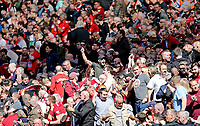 Liverpool fans celebrate after hearing Manchester City were a goal down at Brighton early in the first half<br /> <br /> Photographer Rich Linley/CameraSport<br /> <br /> The Premier League - Liverpool v Wolverhampton Wanderers - Sunday 12th May 2019 - Anfield - Liverpool<br /> <br /> World Copyright © 2019 CameraSport. All rights reserved. 43 Linden Ave. Countesthorpe. Leicester. England. LE8 5PG - Tel: +44 (0) 116 277 4147 - admin@camerasport.com - www.camerasport.com