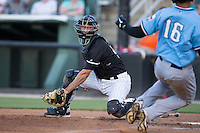 Kannapolis Intimidators catcher Seby Zavala (21) prepares to put the tag on Jose Almonte (16) of the Hickory Crawdads as he slides into home plate at Kannapolis Intimidators Stadium on June 11, 2016 in Kannapolis, North Carolina.  The Crawdads defeated the Intimidators 7-5.  (Brian Westerholt/Four Seam Images)