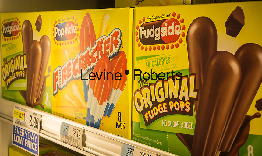 Popsicle and Fudgsicle brand ices are seen in a supermarket freezer in New York on Wednesday, May 8, 2013. Popsicle is a brand of Unilever. (© Richard B. Levine)