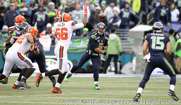 Seattle Seahawks quarterback Russell Wilson (3) prepares to pass to wide receiver Jermaine Kearse  (15) during their game against the Cleveland Browns at CenturyLink Field in Seattle, Washington on December 20, 2015. The Seahawks clinched their fourth straight playoff berth in four seasons by beating the Browns 30-13.  ©2015. Jim Bryant Photo. All Rights Reserved.