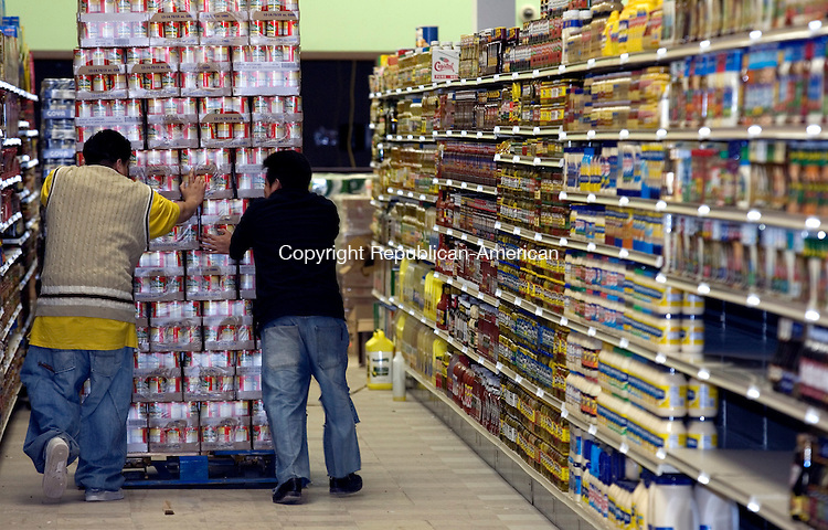 WATERBURY, CT. 14 February 2008-021408SV07--Workers stock shelves at the new Compare Foods International store on Thomaston Ave. in Waterbury Thursday.<br /> Steven Valenti Republican-American