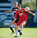 Raith's Edward Malone holds of Partick's Christie Elliot  ...