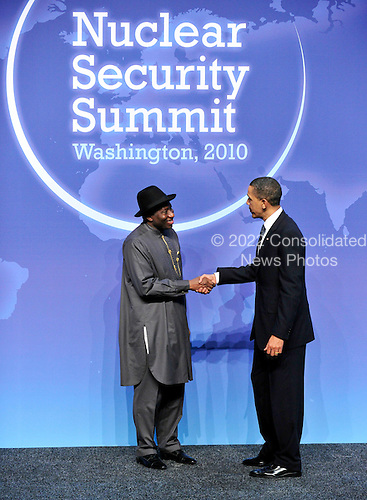 United States President Barack Obama welcomes Acting President Goodluck E. Jonathan of Nigeria to  the Nuclear Security Summit at the Washington Convention Center, Monday, April 12, 2010 in Washington, DC. .Credit: Ron Sachs / Pool via CNP