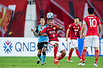 Guangzhou Midfielder Paulinho Maciel (R) Kawasaki Midfielder Nakamura Kengo (L) in action during the AFC Champions League 2017 Group G match between Guangzhou Evergrande FC (CHN) vs Kawasaki Frontale (JPN) at the Tianhe Stadium on 14 March 2017 in Guangzhou, China. Photo by Marcio Rodrigo Machado / Power Sport Images