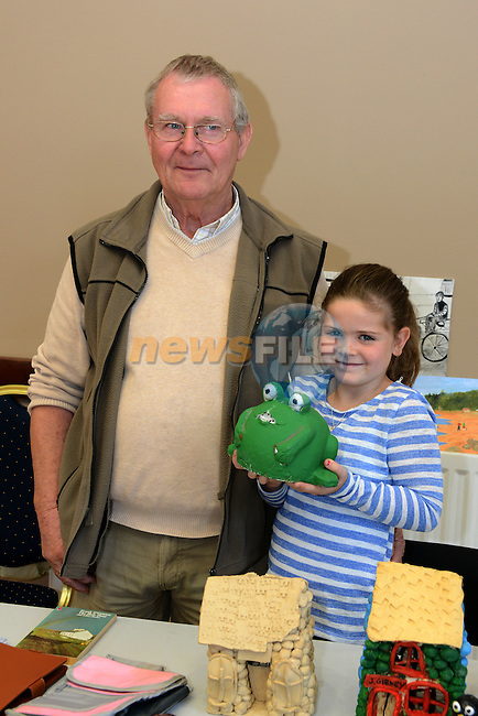 Peter Monaghan with is granddaughter Libby Kenny at the Wheelchair Association coffee morning and sale on Saturday.