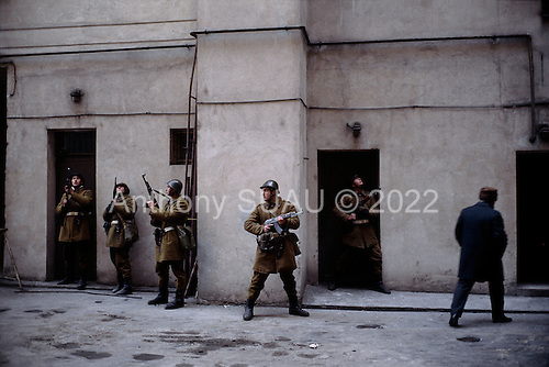 Bucharest, Romania<br /> December 25, 1989<br /> <br /> House to house search for Securitate - the former leader Nicolae Ceausescu's secret police.<br /> <br /> The week-long series of violence that overthrew the Communist regime of Nicolae Ceausescu, ended in a trial and execution of Ceausescu and his wife Elena by firing squad. Romania was the only Eastern Bloc country to violently overthrow its Communist regime or to execute its leaders.<br /> <br /> The Romanian populace was dissatisfied with the Communist regime and leader Ceausescu's economic and development policies were blamed for the country's shortages and widespread poverty. The powerful secret police (Securitate) controlled what was essentially a police state. Ceausescu was not pro-Soviet but &quot;independent&quot; on foreign policy. He imitated the hard-line, megalomania, and personality cults of communist leaders like North Korea's Kim Il Sung.