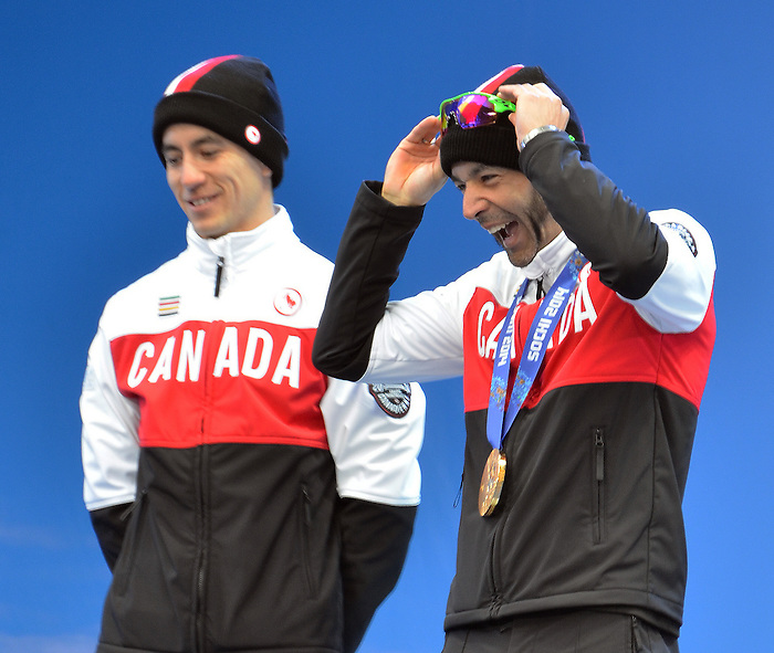 Sochi, Russia, 13/03/2014. Canadian Brian Mckeever and his guide Graham Nishikawa celebrate their gold medals in the cross country skiing men's 1 km sprint visually impaired at the Sochi 2014 Paralympic Winter Games in Sochi Russia.(Photo: Canadian Paralympic Committee)