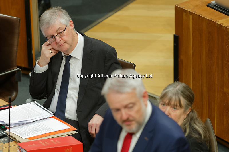 Pictured: First Minister for Wales Carwyn Jones (R) is looked on by successor Mark Drakeford (L). Tuesday 11 December 2018<br /> Re: First Minister for Wales Carwyn Jones during his last First Minister Questions at the Senedd in Cardiff Bay, Wales, UK. He will be succeeded by Assembly Member Mark Drakeford.