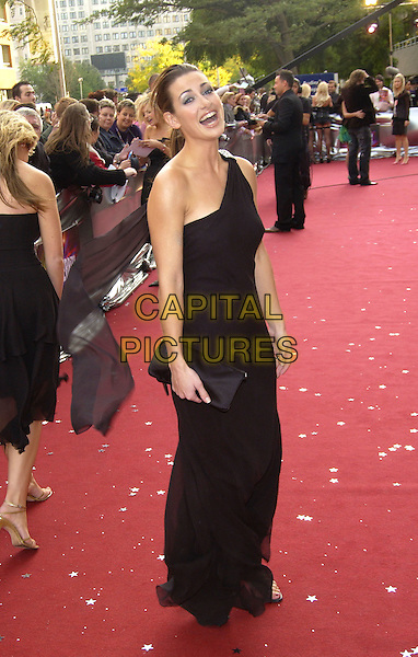 "KIRSTY GALLAGHER.ITV's ""The Celebrity Awards"".London 26 September 2004.full length, one shoulder, black dress, black clutch purse, laughing.www.capitalpictures.com.sales@capitalpictures.com.©Capital Pictures"