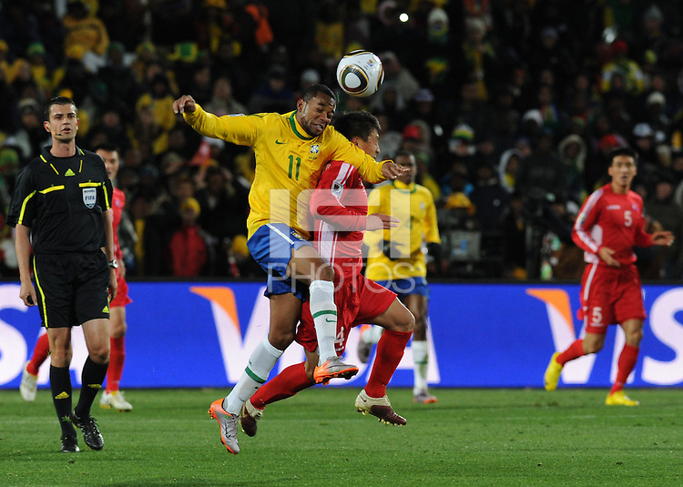 Brazil's Robinho wins a header in a challenge with North Korea's Pak Nam Chol. Brazil defeated North Korea, 2-1, in both teams' opening match of play in Group G of the 2010 FIFA World Cup. The match was played at Ellis Park in Johannesburg, South Africa June 15th.