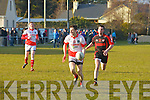 Anton O'Callaghan (St Pats Blennerville) in action with Seanie O'Leary (kenmare Shamrocks) in the Credit Union Senior Football League, 2013, Div 2, Round 2, at St Pats GAA grounds Blennerville on Saturday.
