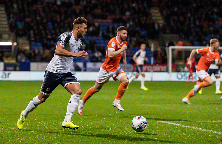 Bolton Wanderers' Dennis Politic (left) breaks<br /> <br /> Photographer Andrew Kearns/CameraSport<br /> <br /> The EFL Sky Bet League One - Bolton Wanderers v Blackpool - Monday 7th October 2019 - University of Bolton Stadium - Bolton<br /> <br /> World Copyright © 2019 CameraSport. All rights reserved. 43 Linden Ave. Countesthorpe. Leicester. England. LE8 5PG - Tel: +44 (0) 116 277 4147 - admin@camerasport.com - www.camerasport.com
