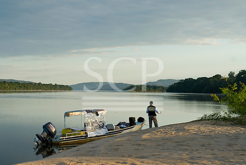 "Pará State, Brazil. Xingu River; early morning island beach; preparing the ""Coração do Brasil""."