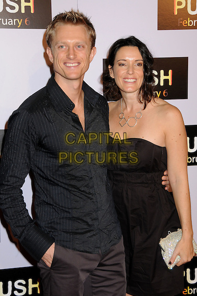 "NEIL JACKSON & KYLIE FURNEAUX.""Push"" Los Angeles Premiere at Mann's Village Theatre, Westwood, California, USA..January 29th, 2009.half length black shirt strapless dress brown .CAP/ADM/BP.©Byron Purvis/AdMedia/Capital Pictures."